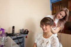 Female hair stylist working with girl Royalty Free Stock Photo