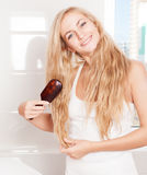 Female with hairbrush Royalty Free Stock Photography