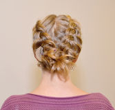 Female hairdress The French braid, rear view.  royalty free stock photography
