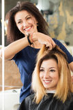 Female hairdresser and client deciding what haircut to do Royalty Free Stock Images