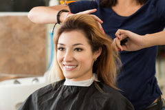 Female hairdresser and client deciding what haircut to do Royalty Free Stock Image
