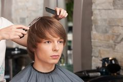 Female hairdresser cutting hair of man client. Stock Photo