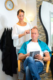 Female hairdresser cutting hair of man Royalty Free Stock Photo