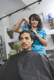 Female Hairdresser Cutting Man's Hair At Salon Royalty Free Stock Photos