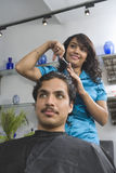 Female Hairdresser Cutting Man's Hair At Salon Stock Photos