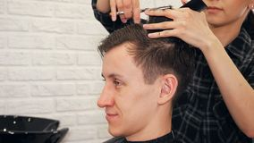 Female hairdresser haircut doing male hair style.  royalty free stock image