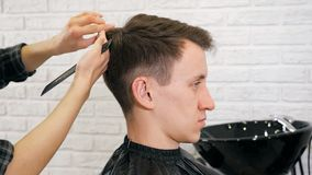Female hairdresser haircut doing male hair style.  stock image