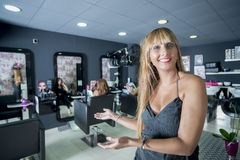 A female Hairdresser portrait looking confidence. Owner of her business royalty free stock image