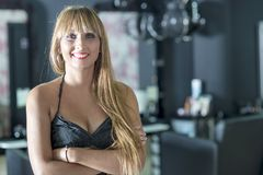 A female Hairdresser portrait looking confidence. Owner of her business royalty free stock images
