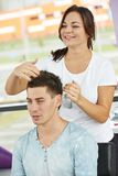 Female hairdresser at work Royalty Free Stock Photos