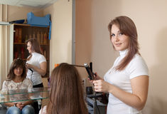 Female hairdresser working with  girl Stock Photos