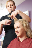 Female Hairdresser Working In Salon Royalty Free Stock Photos