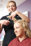 Female Hairdresser Working In Salon Royalty Free Stock Photo