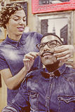 Female hairstylist arranging a moustache Stock Images