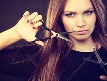 Female hairstylist barber with scissors. Royalty Free Stock Photo