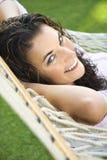 Female in hammock. Stock Photo