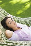 Female in hammock. Stock Image