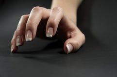 Female hand 2. Hand on dark background Stock Image