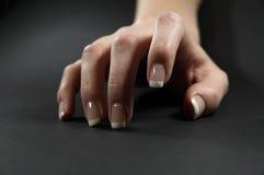 Female hand. Fingers on dark background Stock Photography