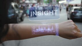Female hand activates hologram Insight