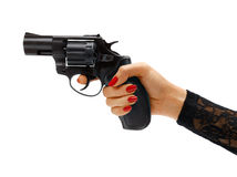 Female hand aiming revolver gun. Studio photography of woman's hand holding handgun - isolated on white background. Business concept Royalty Free Stock Photography