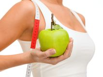 Female hand with apple and measuring tape Stock Photo