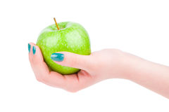 Female hand with an apple Stock Image
