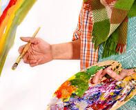 Female hand artist at work Stock Photos