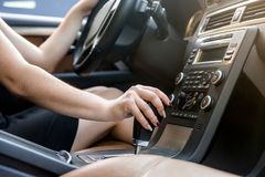 Female hand on automatic transmission car lever. Female hand on automatic transmission car lever stock image