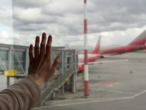 Female hand on the background of the aircraft at the airport royalty free stock image