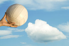 Female  hand  ball  sky  clouds Royalty Free Stock Photos