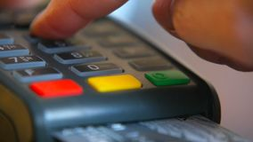 Female hand with a bank card using the terminal for payment. The concept of non-cash payment. Female hand with a bank card using the terminal for payment. The stock video footage