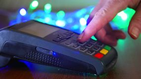 Female hand with a bank card using the terminal for payment. The concept of non-cash payment. Female hand with a bank card using the terminal for payment. The stock footage