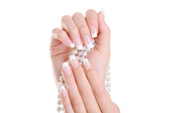 Female hand with beauty french manicure stock photo
