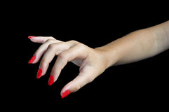 Female hand on black background Royalty Free Stock Images
