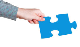 Female hand with blue puzzle piece Stock Photo
