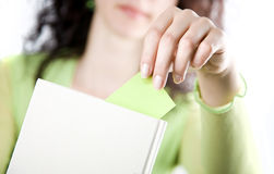 Female hand bookmark book Stock Photography
