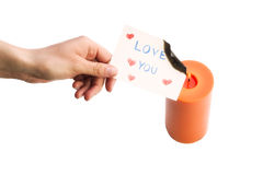 Female Hand Burning a Love Message. Sadness Feeling Royalty Free Stock Images
