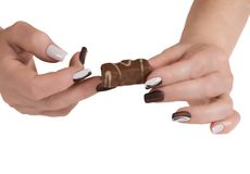 Female hand with a candy Royalty Free Stock Photography