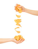 Female hand with chips. Isolated on white royalty free stock image