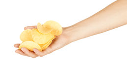 Female hand with chips. Isolated on white background stock photos