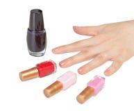 Female hand and choice of color nail polish Royalty Free Stock Photo