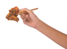Female Hand And Chopstick and Fried Chicken I Stock Photos