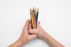Female hand clenched in fist dozen pencils Stock Photography