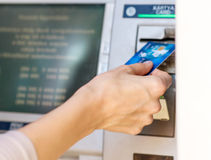 Female hand - close up - cash withdrawals at ATMs Royalty Free Stock Images