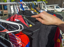 Female hand clothes hanger street market Royalty Free Stock Image