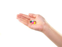 Female hand with colorful pills isolated Royalty Free Stock Image