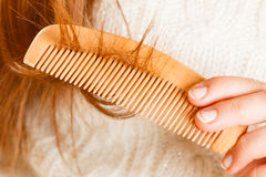 Female hand combing long hair. Stock Photos