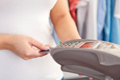 Female hand controls payment terminal Royalty Free Stock Photography