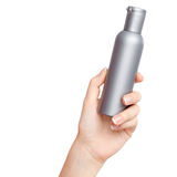 Female hand with a cosmetics bottle Royalty Free Stock Photo